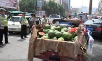 Police buy melons from street vendor after giving him a parking fine